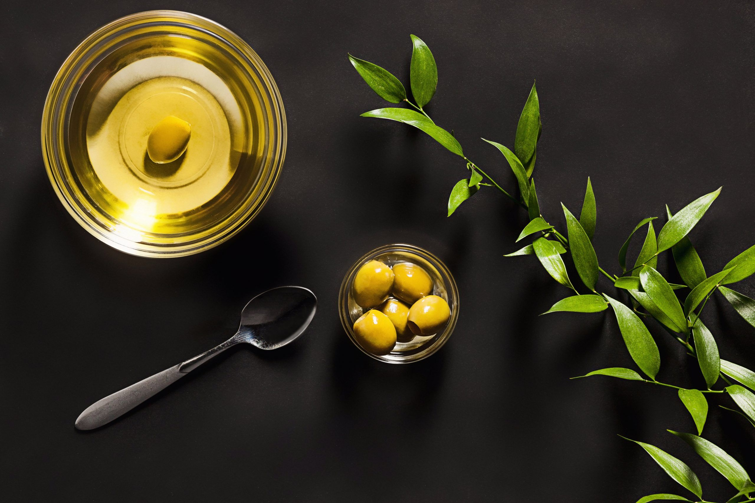 Olives and olive oil table black